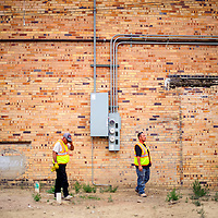 081914       Cable Hoover<br /> <br /> Construction supervisors Lawrence Ulibarri, left, and Steve Salazar pace through the site of the  El Morro Theatre expansion during a groundbreaking ceremony Tuesday in Gallup.