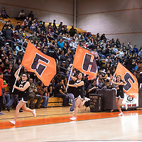 The cheerleaders for Gallup High School run across the gym carrying these flags followed by the team at the 75th Annual Gallup Boys Invitational Basketball Tournament, Saturday, Jan. 5, 2019 at Gallup High School.