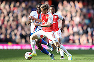 Yannick Bolasie of Crystal Palace is challenged by Nacho Monreal of Arsenal. Barclays Premier league match, Arsenal v Crystal Palace at the Emirates Stadium in London on Sunday 17th April 2016.<br /> pic by John Patrick Fletcher, Andrew Orchard sports photography.