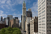 Modern architecture and the 1903 Gothic Woolworth building tallest in the centre, in Manhattan, New York City. High-rise buildings are mostly corporate offices though some apartments in this, one of the world's great megacities. They occupy addresses along Broadway - a mixture of modernity and 19th century architecture can be seen as a wide panorama. The Woolworth Building, at 233 Broadway, Manhattan, New York City, designed by architect Cass Gilbert and completed in 1913, is an early US skyscraper. The original site for the building was purchased by F. W. Woolworth and his real estate agent Edward J. Hogan by April 15, 1910, from the Trenor Luther Park Estate and other owners for $1.65 million.