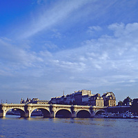 The Pont Neuf on an autumn  afternoon in Paris spanning the Seine and connecting the Left Bank to the Right Bank. The oldest bridge in Paris on the Seine.