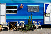 A bright blue caravan along the A5 has been converted into a roadside cabin cafe and is open for business on the 19th April 2011 in Betws-y-coed in the United Kingdom.