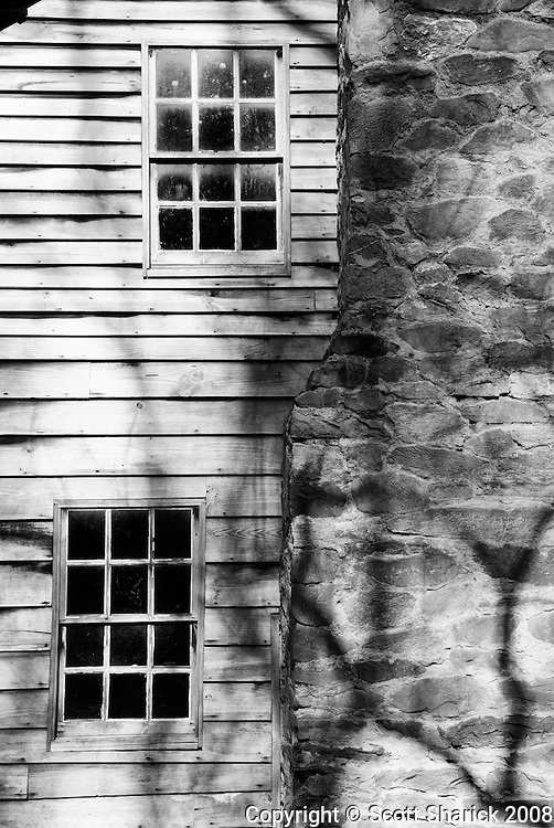 The sun hits the side of an old home in the Great Smoky Mountains National Park in Tennessee.