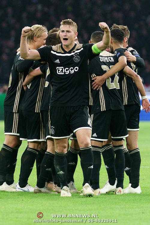NLD/Amsterdam/20181023 - Champions Leaguewedstrijd  Ajax - SL Benfica, blijdschap bij ajax na de overwinning, nr. 4 Matthijs de Ligt