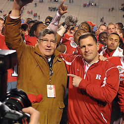Dec. 29, 2008; Birmingham, AL, USA; Rutgers head coach Greg Schiano (right) and deposed athletic director Bob Mulcahy (left) celebrate the Rutgers Scarlet Knights' victory over the N.C. State Wolfpack 29-23 in the Papajohns.com Bowl at Legion Field.