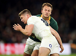 File photo dated 03-11-2018 of England's Owen Farrell tackles South Africa's Andre Esterhuizen.