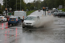© Licensed to London News Pictures. 02/10/2020. London, UK. A car drives through a flood in north London as Storm Alex arrives from Europe. The Met Office forecasts heavy rain and windy weather for the next few days in the capital, caused by Storm Alex. Photo credit: Dinendra Haria/LNP