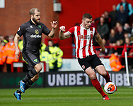 Jack O'Connell of Sheffield Utd clears from Teemu Pukki of Norwich City during the Premier League match at Bramall Lane, Sheffield. Picture date: 7th March 2020. Picture credit should read: Simon Bellis/Sportimage