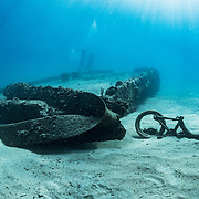 A child's bicycle lays next to a large concrete dock underwater off Crash Boat Beach, in Puerto Rico's northwest. The dock and marina sustained significant damage during hurricanes Maria and Irma in 2017. Dock pilings were bent right over, destroying the marina, and the life that was living on them, including large sponges and anemonies. In 2020 they are just beginning to come back.