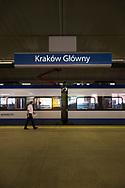 A man walks outside an intercity train inside Krakow Glowny, the train station in Krakow, Poland.