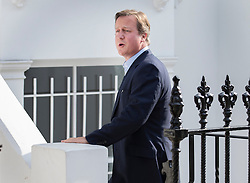 © Licensed to London News Pictures. 13/09/2016. London, UK. Former Prime Minister David Cameron talks to a neighbour (unseen) as he arrives at a new London address on the day after he resigned as an Member of Parliament. Photo credit: Peter Macdiarmid/LNP