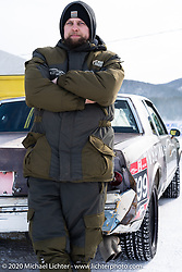 Mechanic Roman Nepovinnykh with the Big Boys Big Toys 1981 Chevy Monte Carlo racer at the Baikal Mile Ice Speed Festival. Maksimiha, Siberia, Russia. Wednesday, February 26, 2020. Photography ©2020 Michael Lichter.