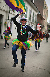 17 Feb 2015. New Orleans, Louisiana.<br /> Fat Tuesday. Mardi Gras Day. A reveler dressed in costume enjoys the day.<br /> Photo; Charlie Varley/varleypix.com