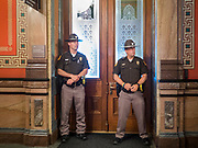 15 JUNE 2020 - DES MOINES, IOWA: Iowa State Troopers guard the door to the Governor's Reception Room in the Iowa capitol in Des Moines. About 75 supporters of Black Lives Matter marched through the Iowa capitol Monday to demand the restoration of voting rights for felons who have completed their sentences. Iowa is one of only two states in the US that permanently strip felons of voting rights. The issue is a  racial one in Iowa. Blacks make up only 4 percent of the population but 25 percent of the prison population. The Governor agreed to meet with a delegation of the protesters but she would not commit to immediately restoring voting rights. She said would draft an executive order to restore voting rights later in the summer.   PHOTO BY JACK KURTZ