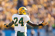 North Dakota State Bison cornerback Bryan Shepherd (24) pumps up his team after a play during the FCS title game against Sam Houston State at FC Dallas Stadium in Frisco, Texas, on January 5, 2013.  (Stan Olszewski/The Dallas Morning News)