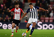 Jake Livermore of West Bromwich Albion battles with Shane Long of Southampton .Premier league match, Southampton v West Bromwich Albion at the St. Mary's Stadium in Southampton, Hampshire, on Saturday 21st  October 2017.<br /> pic by Bradley Collyer, Andrew Orchard sports photography.