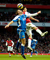 Photo: Ed Godden/Sportsbeat Images.<br /> Arsenal v Wigan Athletic. The Barclays Premiership. 11/02/2007. Arsenal's Cesc Fabregas (R), colides with Matt Jackson in the air.