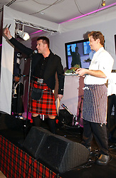 COLIN McGREGOR brother of Ewan McGregor and the Haggis being broght to dinner at a Burns Night dinner in aid of CLIC Sargent and Children's Hospice Association Scotland held at St.Martin's Lane Hotel, St.Martin's Lane, London on 25th January 2007.<br />