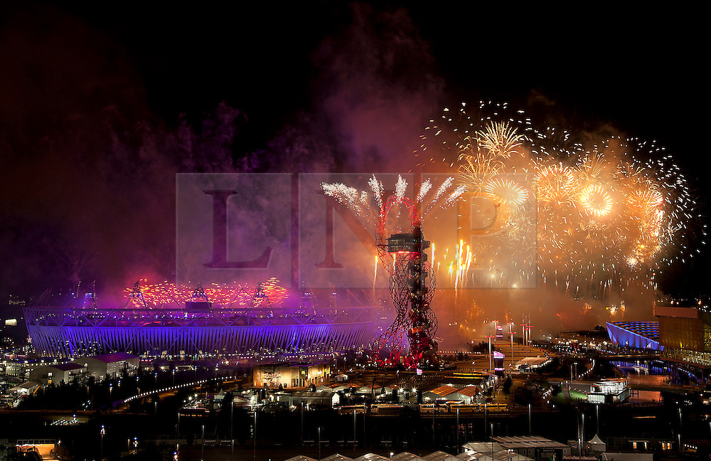 © Licensed to London News Pictures. 28/07/2012. LONDON, UK. Fireworks are seen over the Olympic Stadium during the opening ceremony of the 2012 Summer Olympics is seen in London today (28/07/12). Constituting the third time the Olympic Games have been held in Great Britain, the 2012 Olympic Games, also known as the Games of the XXX Olympiad opened this evening with a show, put together by 'Slum Dog Millionaire' director Danny Boyle, entitled 'The Isles of Wonder. Photo credit: Matt Cetti-Roberts/LNP