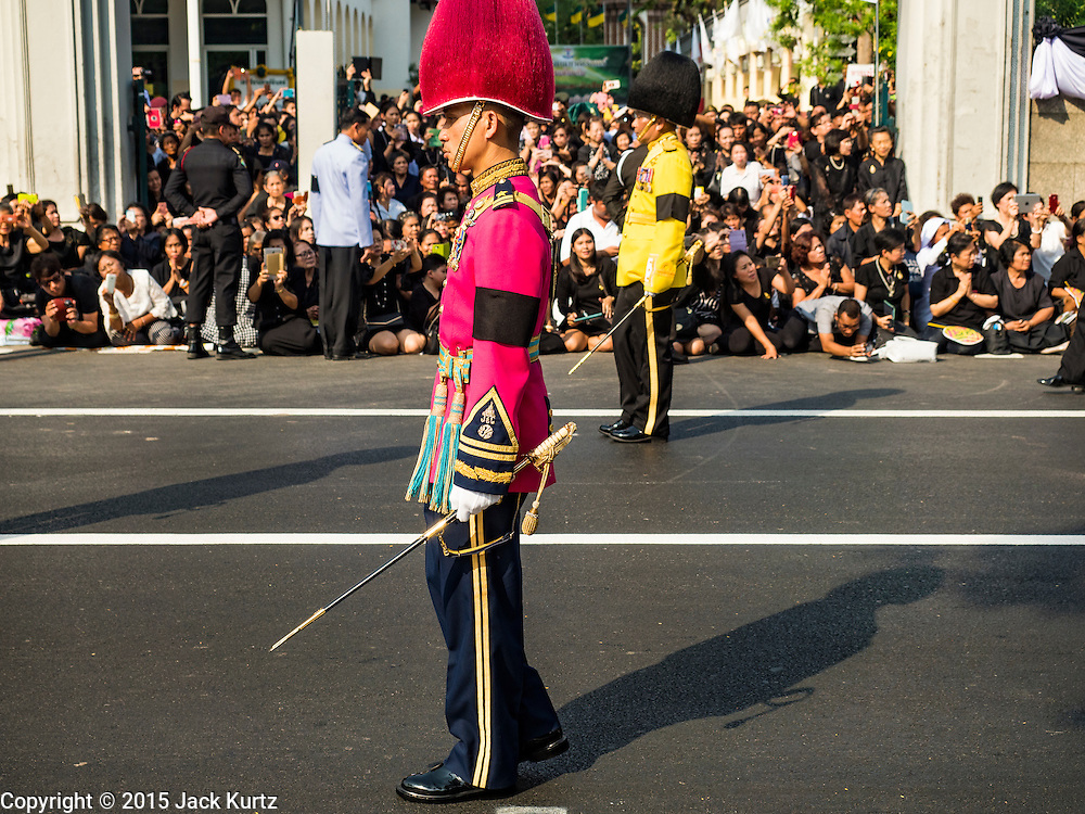16 DECEMBER 2015 - BANGKOK, THAILAND: Members of an honor guard walk past the crowd during the funeral procession for Somdet Phra Nyanasamvara, who headed Thailand's order of Buddhist monks for more than two decades and was known as the Supreme Patriarch. The Patriarch died in 2013. He was ordained as a Buddhist monk in 1933 and appointed as the Supreme Patriarch in 1989. He was the spiritual advisor to Bhumibol Adulyadej, the King of Thailand when the King served as a monk in 1956. Tens of thousands of people lined the streets during the procession to pray for the Patriarch.     PHOTO BY JACK KURTZ