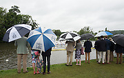 Henley on Thames. United Kingdom. Spectators watch, in the rain,  the racing at the start. Wednesday,  29/06/2016,   11:16:30   2016 Henley Royal Regatta, Henley Reach.   [Mandatory Credit Peter Spurrier/ Intersport Images]