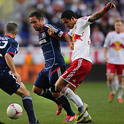 Tim Cahill, New York Red Bulls, is challenged by Daniel Paladini, Chicago Fire, in action during the New York Red Bulls V Chicago Fire Major League Soccer regular season match at Red Bull Arena, Harrison. New Jersey. USA. 6th October 2012. Photo Tim Clayton