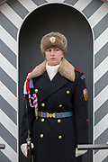 A female guard wears the Ruritanian-style uniform outside Prague Castle, at Hradcany-Prazsky Hrad (Prague Castle), on 18th March, 2018, in Prague, the Czech Republic. Ater the Velvet Revolution in 1990 when the communist regime ended, Václav Havel, the first President of the Czech Republic wanted his guards's uniforms to be different from the khaki ones the communists wore and the basic ones found in neighboring countries. Havel chose Theodor Pistek, the Czech born artist and costume designer who won an Academy Award for Best Costume Design for the 1984 film Amadeus.