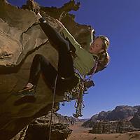 Lisa Gnade rock climbs in Rakabat Siq (canyon) on Jebel Um Ishrin in the Wadi Rum, Jordan.