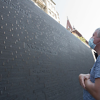 Man visit the newly inaugurated Memorial of Unity that is decorated with names of Hungarian towns (many of them belonging to neighbouring countries since the Treaty of Trianon) engraved onto the walls on the national holiday celebrating the foundation of the Hungarian State in Budapest, Hungary  on Aug. 20, 2020. ATTILA VOLGYI