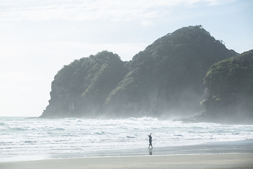 People enjoy being at Bethell's beach,Te Henga, on the west coast of Auckland, New Zealand