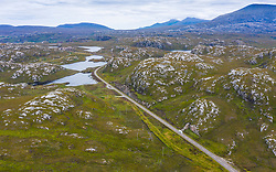 Aerial view of highway part of North Coast 500 tourist route north of Kylesku in Sutherland, Highland Region, Scotland UK
