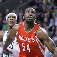 06 March 2012: Houston Rockets power forward Luis Scola (4)5 vies for the rebound with Boston Celtics point guard Rajon Rondo (9) during the Boston Celtics 97-92 (OT) victory over the Houston Rockets at the TD Garden, Boston, Massachusetts, USA.