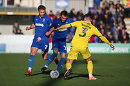 AFC Wimbledon attacker Shane McLoughlin (19) battles for possession with Fleetwood Town defender Danny Andrew (3) during the EFL Sky Bet League 1 match between AFC Wimbledon and Fleetwood Town at the Cherry Red Records Stadium, Kingston, England on 8 February 2020.