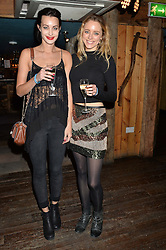 Left to right, sisters EMILY HARTRIDGE and JESSICA HARTRIDGE at Skiing With Heroes Junior Committee Awareness Party held at Bodo's Schloss, 2A Kensington High Street, London on 6th November 2014.
