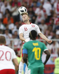 MOSCOW, June 19, 2018  Jakub Blaszczykowski (top) of Poland competes during a Group H match between Poland and Senegal at the 2018 FIFA World Cup in Moscow, Russia, June 19, 2018. (Credit Image: © Cao Can/Xinhua via ZUMA Wire)