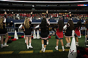 The Iraan High School cheerleaders rally the fans during the state championship game at AT&T Stadium in Arlington, Texas on December 15, 2016. (Cooper Neill for The New York Times)