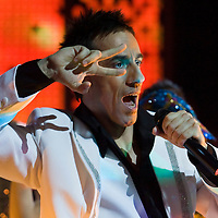 Singer Andras Csonka performs mimicking the famous gesture of John Travolta.