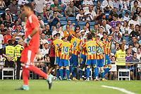 Real Madrid's Keylor Navas and Valencia's Jose Luis Gaya, Simone Zaza, Nacho Vidal and Toni Lato celebrating a goal during La Liga match between Real Madrid and Valencia CF at Santiago Bernabeu Stadium in Madrid, Spain August 27, 2017. (ALTERPHOTOS/Borja B.Hojas)