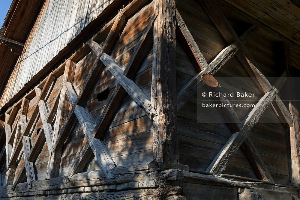 The timbers of a traditional Slovenian barn in a rural village, on 19th June 2018, in Bohinjska Bela, Bled, Slovenia.