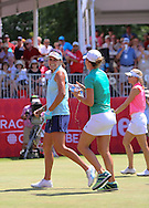 26JUL15 Lexi Thompson is doused with water on the 18th green after her final putt at Sunday's Final Round of The Meijer LPGA Classic at The Blythefield Country Club in Belmont, Michigan. (photo credit : kenneth e. dennis/kendennisphoto.com)