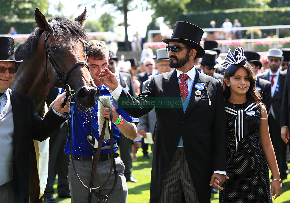 Sheikh Mohammed bin Rashid Al Maktoum and daughter in the winners encloser during day one of Royal Ascot at Ascot Racecourse.