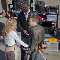 Actor Jai Courtney (R) of Australia and Sebastian Koch (top) of Germany costars of the fifth piece in the Die Hard series titled Good Day to Die Hard is seen among members of the crew during a shooting day in Budapest, Hungary on May 19, 2012. ATTILA VOLGYI