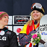 Lindsey Jacobellis (USA) and Olivia Nobs (SUI) celebrate during the awards ceremony for the Ladies Snowboard-Cross event at the LG Snowboard World Cup held at Cypress Mountain, British Columbia on February 13th, 2009. Mandatory Photo Credit: Bella Faccie Sports Media\Thomas Di Nardo. Contact: Thomas Di Nardo, Snohomish, Washington, USA. Telephone 425-260-8467. e-mail: tom@bellafaccie.com