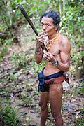 Mentawai indigenous man with machete (Indonesia).