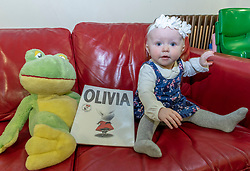 The most popular baby names in Scotland have been announced at Leith Library in Edinburgh. The most names for 2018 are unchanged from 2017 with Jack and Olivia taking the top spots.<br /> <br /> Pictured: 8 month old Ailsa Stewart holding a book titled with the most popular girl's name, Olivia