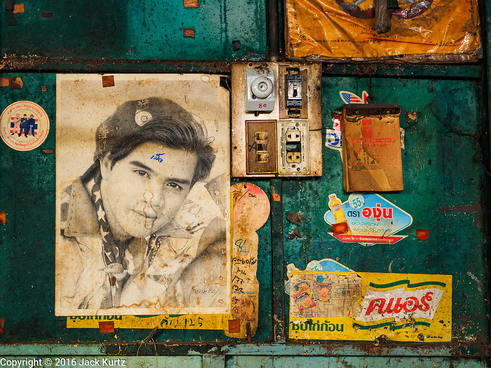 05 JANUARY 2016 - BANGKOK, THAILAND:          A poster of a Thai teen heart throb on a wall in a stall in the closed Bang Chak Market. The market closed permanently on January 4, 2016. The Bang Chak Market served the community around Sois 91-97 on Sukhumvit Road in the Bangkok suburbs. Bangkok city authorities put up notices in late November that the market would be closed by January 1, 2016 and redevelopment would start shortly after that. Market vendors said condominiums are being built on the land.                   PHOTO BY JACK KURTZ