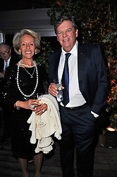 ROSITA, DUCHESS OF MARLBOROUGH and JOHANN RUPERT at a dinner hosted by Cartier in celebration of the Chelsea Flower Show held at Battersea Power Station, 188 Kirtling Street, London SW8 on 23rd May 2011.
