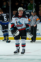 KELOWNA, BC - JANUARY 3: Jake Lee #21 of the Kelowna Rockets gathers gear from the ice and skates to the bench against the Victoria Royals  at Prospera Place on January 3, 2020 in Kelowna, Canada. (Photo by Marissa Baecker/Shoot the Breeze)