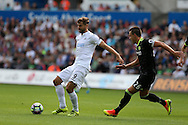 Fernando Llorente of Swansea city gets away from John Terry of Chelsea.Premier league match, Swansea city v Chelsea at the Liberty Stadium in Swansea, South Wales on Sunday 11th Sept 2016.<br /> pic by  Andrew Orchard, Andrew Orchard sports photography.