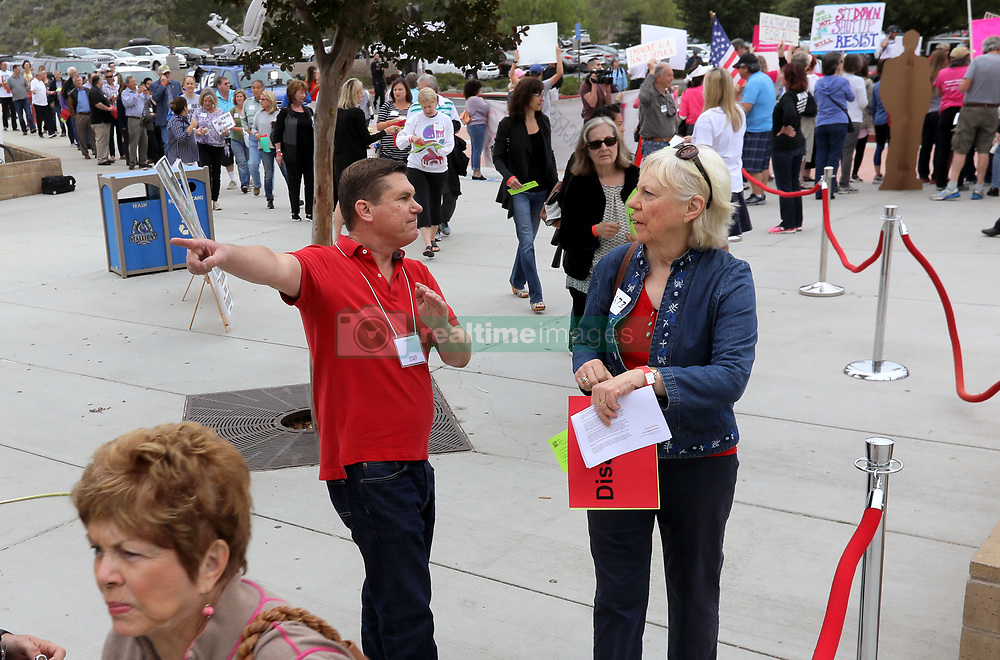June 3, 2017 - San Juan Capistrano, California, United States - June 3, 2017_San Juan Capistrano, California_USA_  At the Representative Issa Town Hall Meeting at San Juan High School an event staff member directs attendees into the school's theater for the meeting.  _Photo Credit: Photo by Charlie Neuman (Credit Image: © Charlie Neuman via ZUMA Wire)